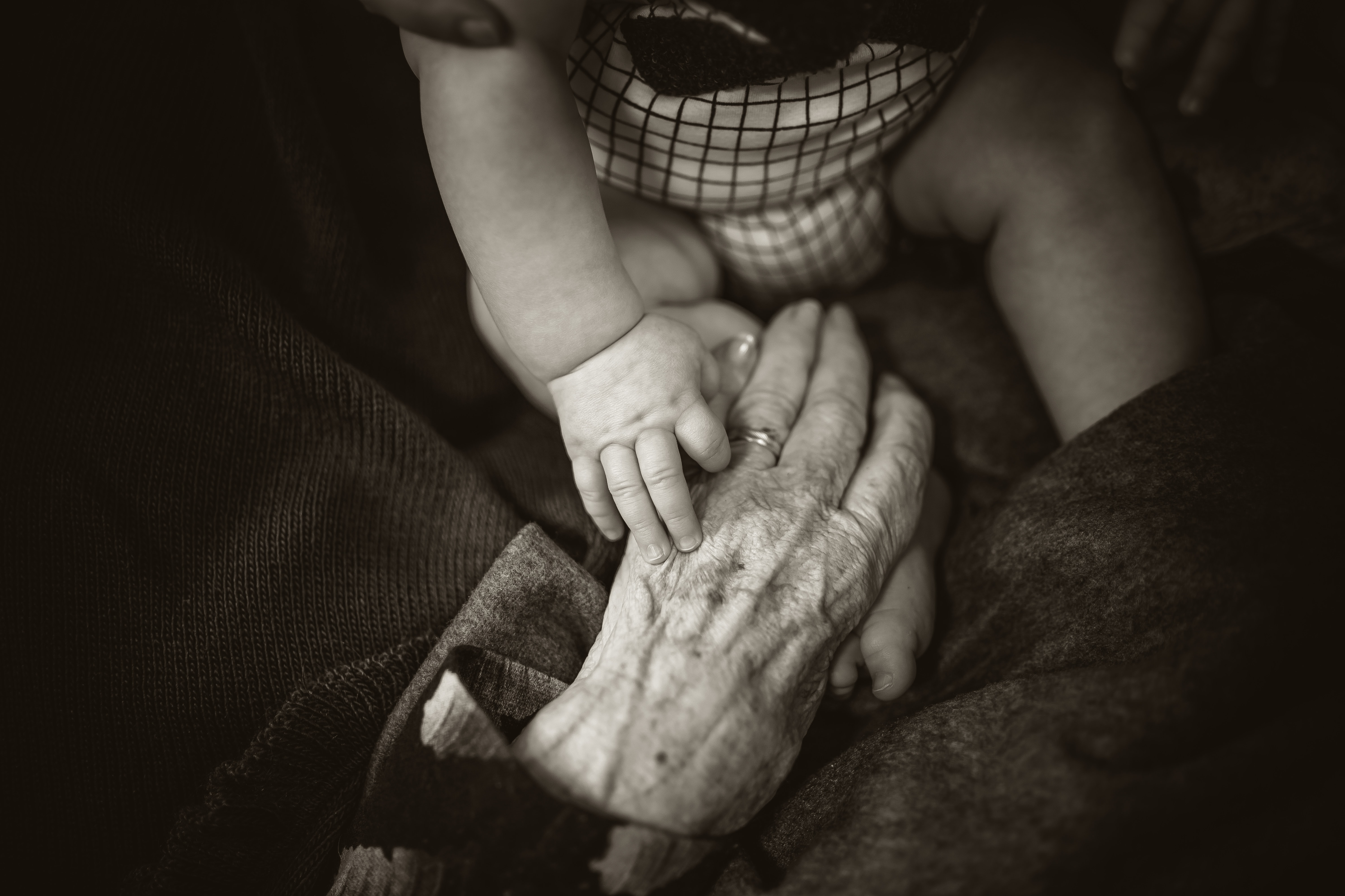 Image of old person and baby