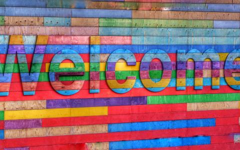 Image of the word Welcome on a multicoloured wall