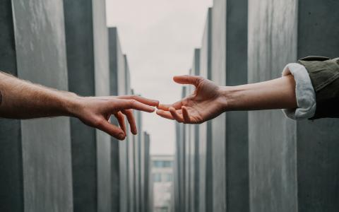 Image of two hands touching